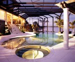 Luxury Residential Watefront Pool & spa lit at night