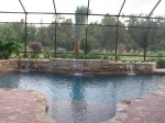 Custom Residential Pool & Spa with rock features and sheet descent