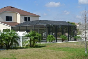 Bronze Mansard Pool Cage with 6 foot solid vinyl fence and 4 foot picket fence