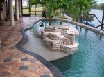 Faux rock island with bishops hat pavers