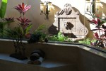 Indoor outdoor bath with custom fountain