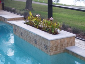 Raised planter with precast coping