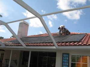 solar heating system for residential swimming pool mounted on tile roof