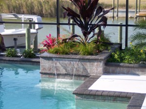 Sheer descent geometric pool and planters