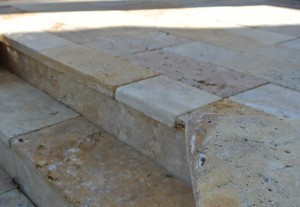 Travertine tile step detail with overhang